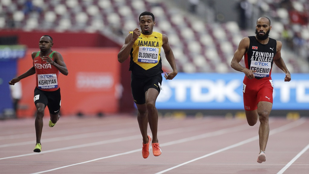 Alphas Leken Kishoyian, of Kenya, left, Akeem Bloomfield, of Jamaica, centre, and Machel Cedenio, of Trinidad And Tobago race in a men's 400m heat at the World Athletics Championships in Doha, Qatar, Tuesday, Oct. 1, 2019. (AP Photo/Petr David Josek).