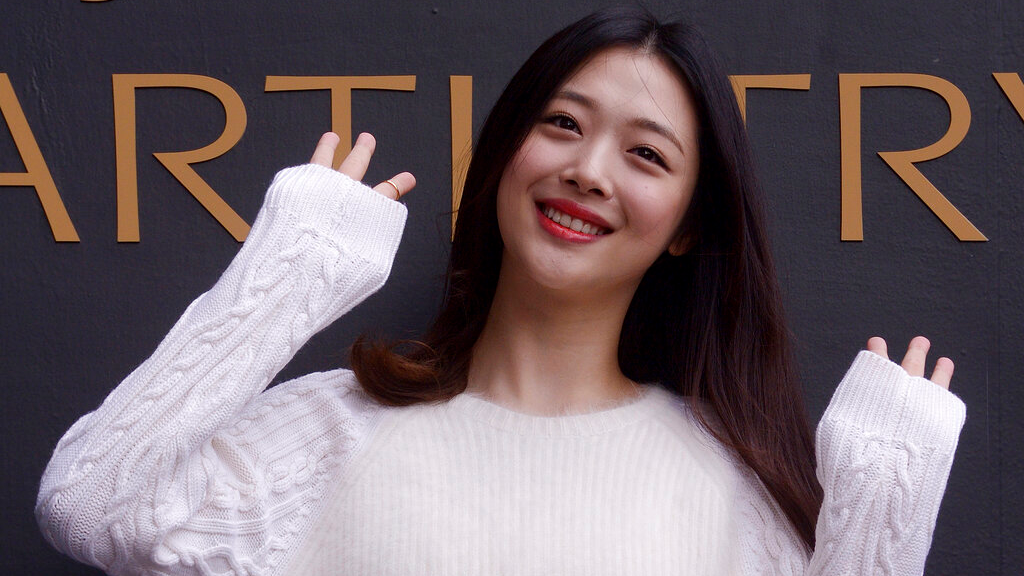 In this Sept. 30, 2015, photo, South Korean pop star and actress Sulli poses during the K-Beauty Close-Up event in Seoul, South Korea. News reports on Monday, Oct. 14, 2019, say Sulli has been found dead at her home south of Seoul. (Jang Se-young/Newsis via AP)