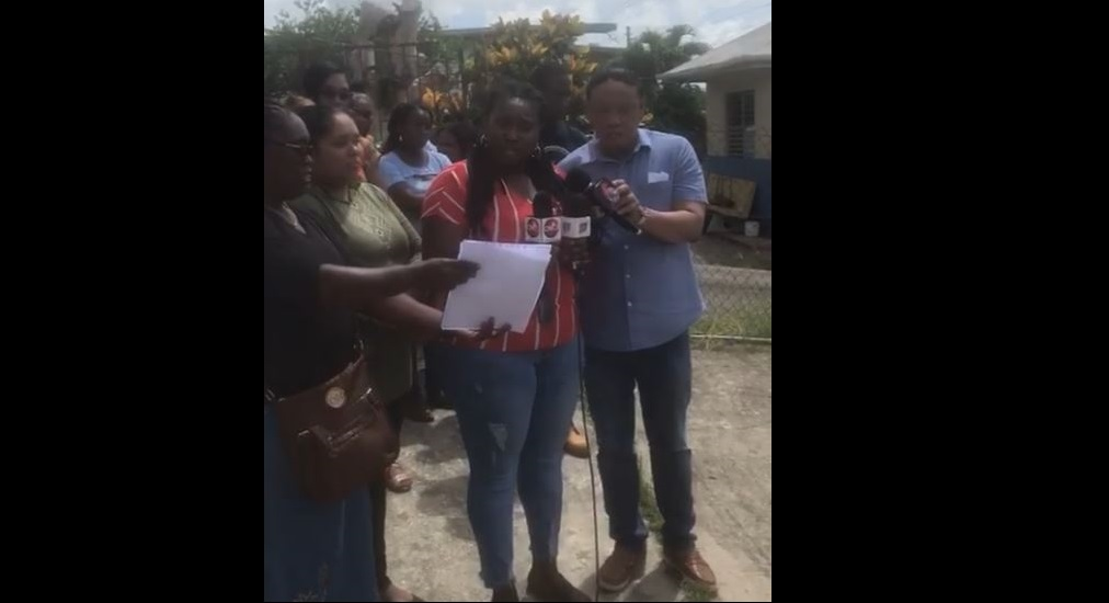 Parent, Meghan Charles, speaks to members of the media during protest action at the Claxton Bay Junior Anglican School. Photo courtesy MP David Lee.