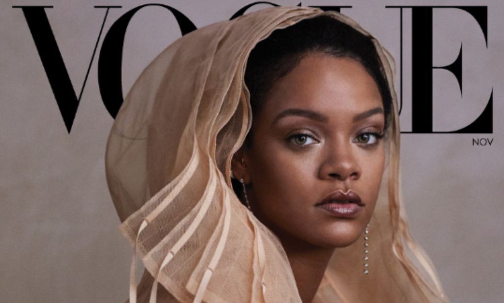 Photo caption: Rihanna wears a Fenty tulle coat. Forevermark and Maria Tash earrings. Hair, Yusef Williams; makeup, Kanako Takase. Fashion Editor: Tonne Goodman.Photographed by Ethan James Green, Vogue, November 2019