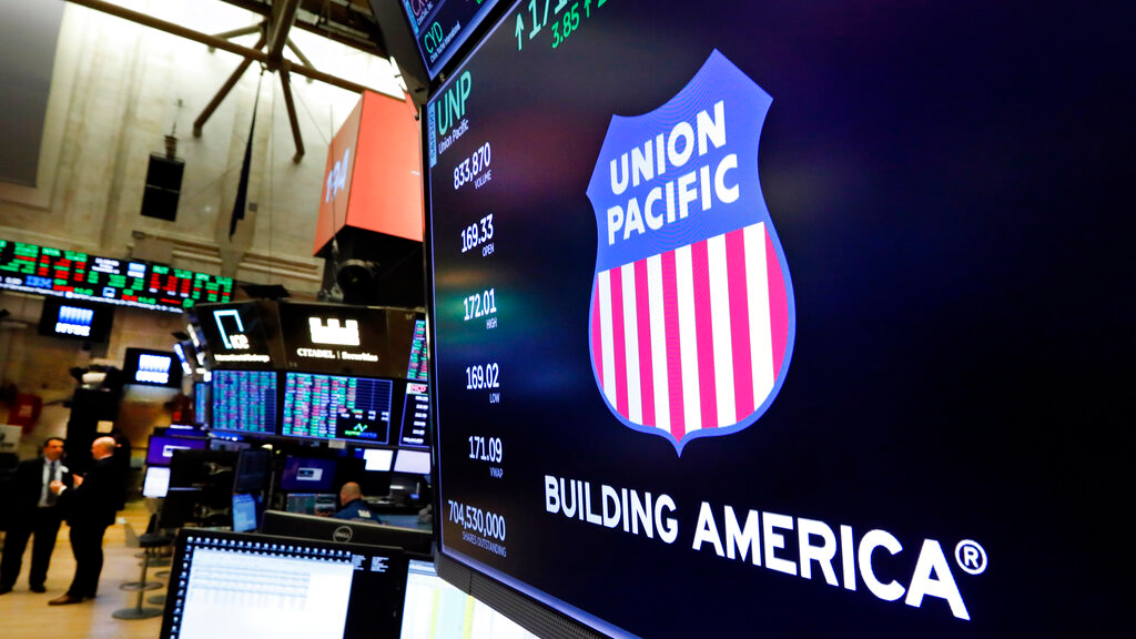 FILE - In this September 13, 2019, file photo the logo for Union Pacific appears above a trading post on the floor of the New York Stock Exchange. Union Pacific Corp. reports financial results October 17. (AP Photo/Richard Drew, File)