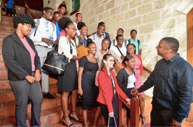 Minister Wilfred Abrahams and the BWA interns when they toured the Parliament Buildings.