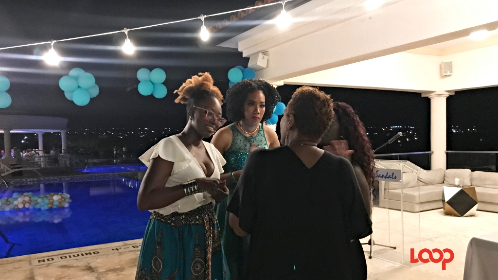 246 Teal Founder, Cherrie-Ann Hurley (left) chatting with persons at the launch at Sandals Royal in Barbados.