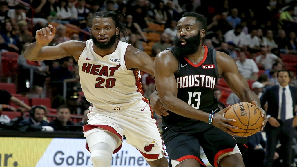 Houston Rockets guard James Harden (13) drives past Miami Heat forward Justise Winslow (20) in the first half of an NBA preseason basketball game Friday, October 18, 2019, in Miami. (AP Photo/Joe Skipper)