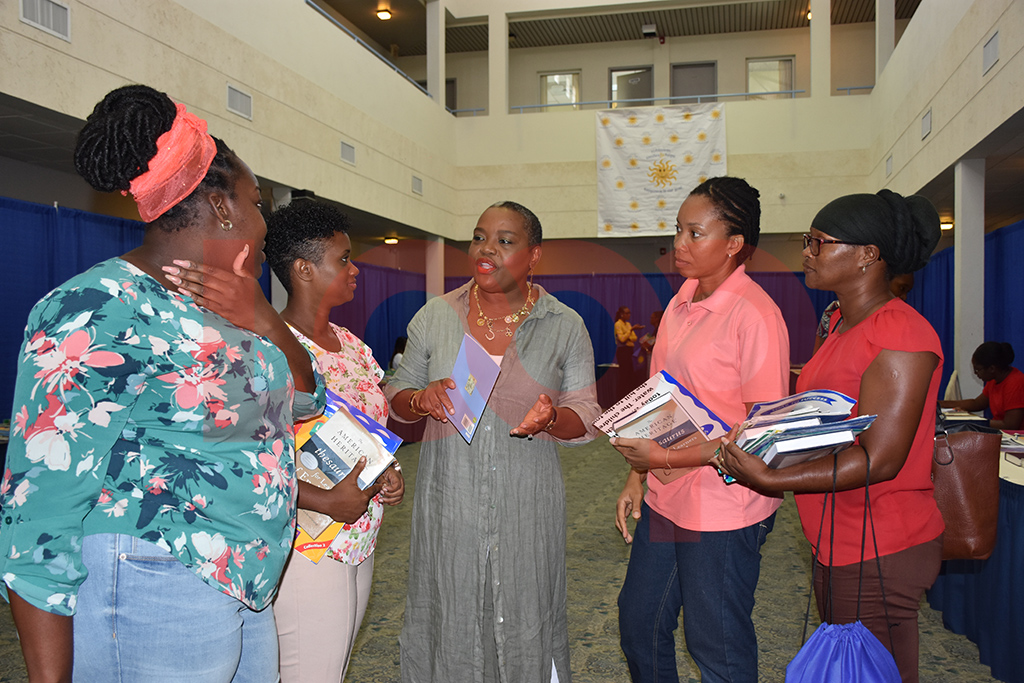 Director of the Robinson Smiles and Hope Foundation , Julia Robinson (centre) in discussions with teachers at the Challenor Creative Arts and Training Centre,  Tonia Burgess (left), Janelle Corbin (second left),  Alison Sealy (second right) and Sharon Bennett (right)