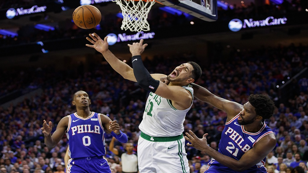 Philadelphia 76ers' Joel Embiid, right, fouls Boston Celtics' Enes Kanter during the second half of an NBA basketball game Wednesday, Oct. 23, 2019, in Philadelphia. Embiid was called for a flagrant foul. The 76ers won 107-93. (AP Photo/Chris Szagola).