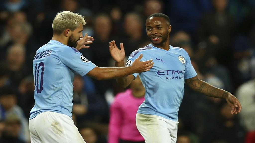 Manchester City's Raheem Sterling, left, celebrates with his teammate Sergio Aguero after scoring his side's fifth goal, during the Group C Champions League  match against Atalanta at the Etihad Stadium in Manchester, England, Tuesday, Oct. 22, 2019. (AP Photo/Dave Thompson).