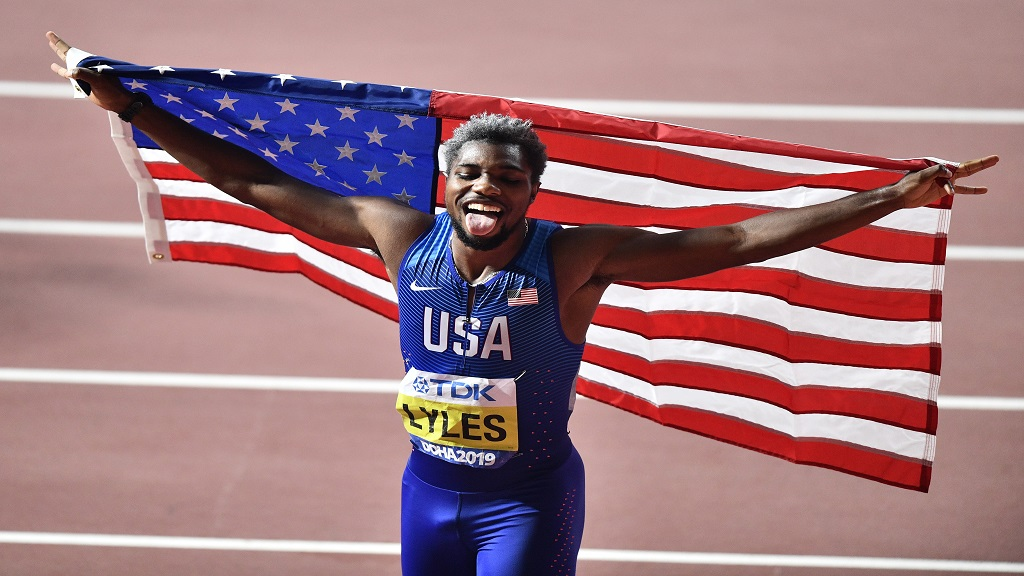Noah Lyles of the U.S., celebrates winning a gold medal in the men's 200m final at the World Athletics Championships in Doha, Qatar, Tuesday, Oct. 1, 2019. (AP Photo/Martin Meissner).