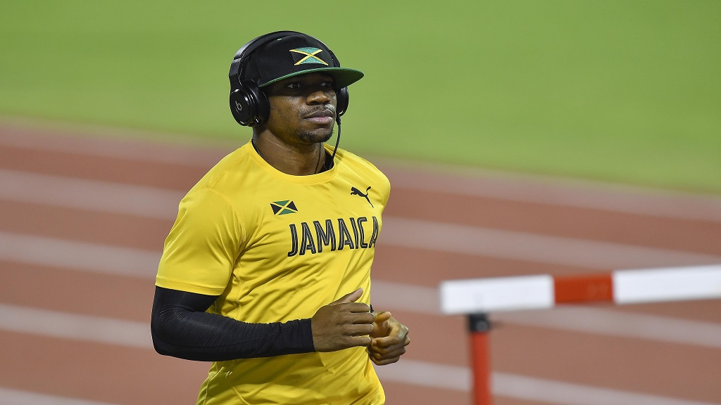 Jamaica's Yohan Blake exercises during an evening training session prior the start of the World Athletics Championships in Doha, Qatar, Wednesday, September 25, 2019. (AP Photo/Martin Meissner)