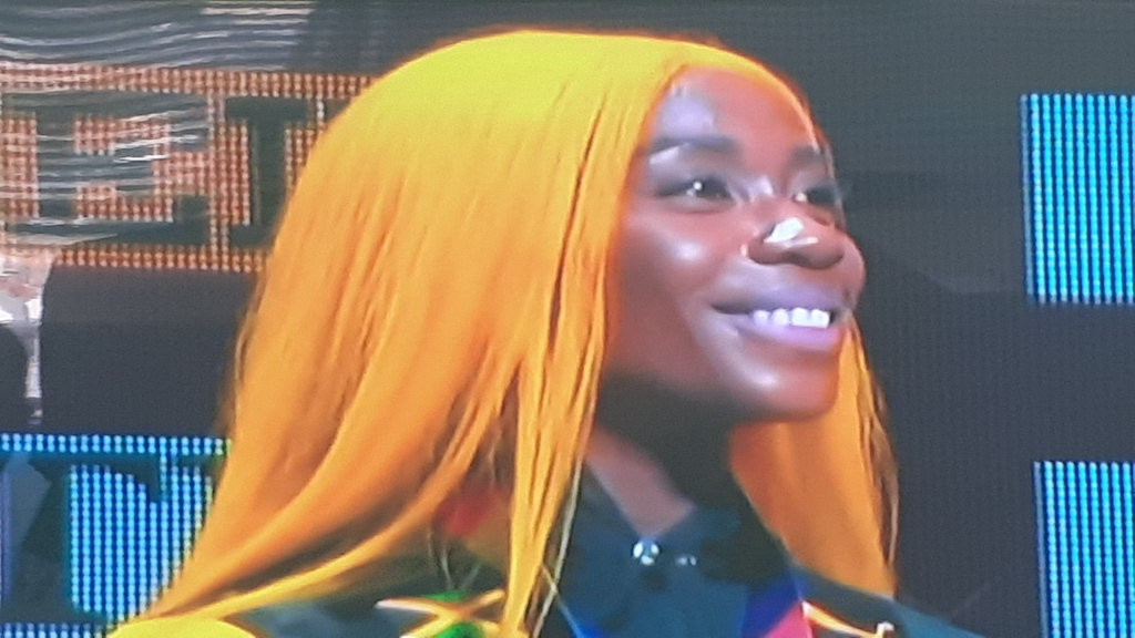 Shelly-Ann Fraser Pryce beams with national pride...