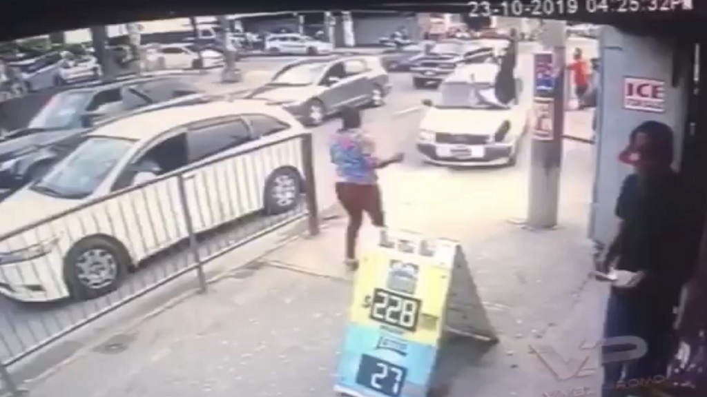 A Screen grab from CCTV footage showing the moment that pedestrians are being mowed down by an out-of-control taxi in Half-Way Tree, St Andrew on Wednesday.