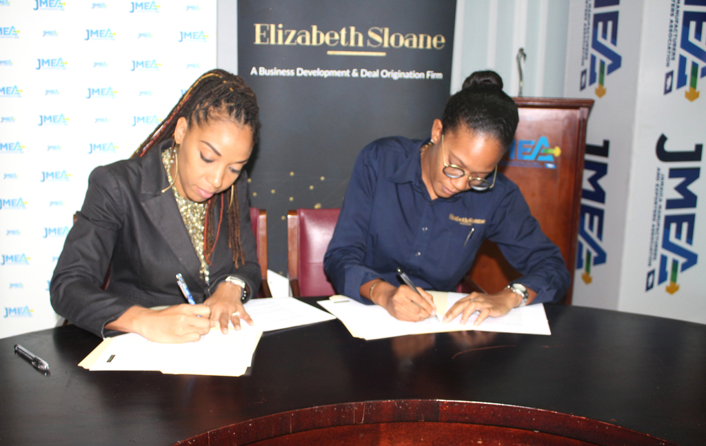 Imega Breese McNab, (left) Executive Director at JMEA sign the MoU with Melanie Wynter- Chief Executive Officer of St. Elizabeth Sloane & Company