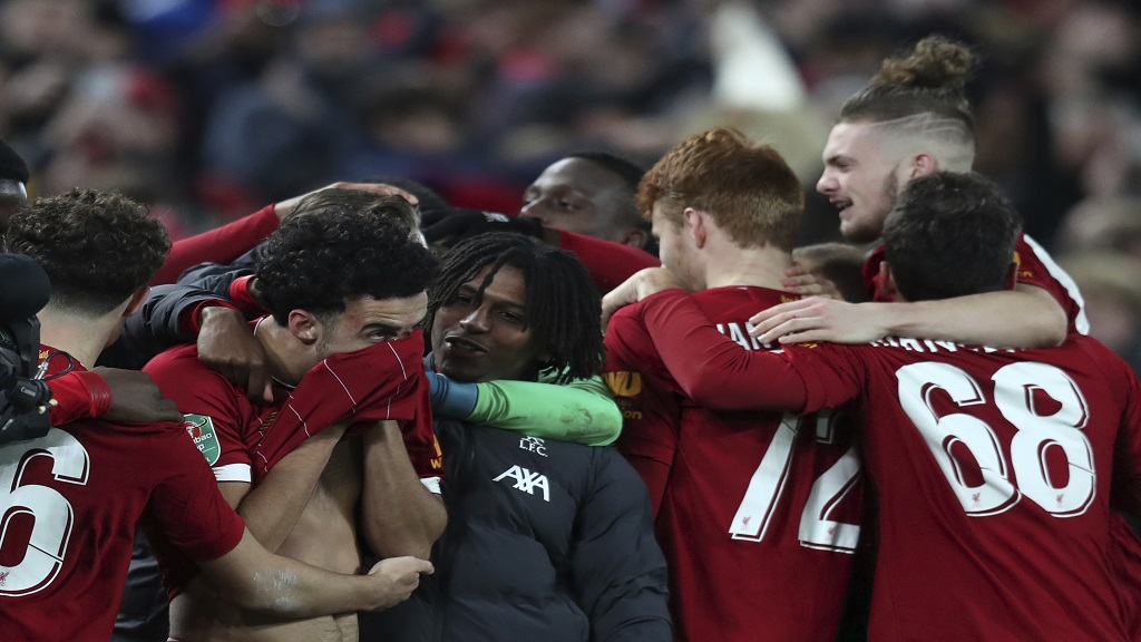 Liverpool players celebrate at the end of the English League Cup football match against Arsenal at Anfield stadium in Liverpool, England, Wednesday, Oct. 30, 2019. (AP Photo/Jon Super).