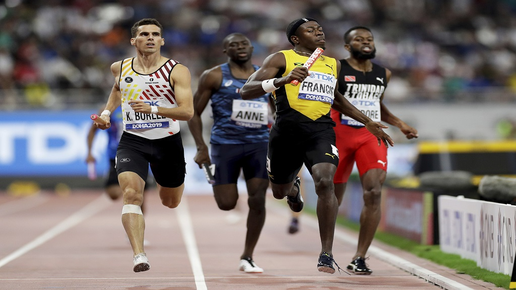 Belgium's Kevin Borlee, left, and Jamaica's Javon Francis race to the finish in a men's 4x400m relay heat at the World Athletics Championships in Doha, Qatar, Saturday, Oct. 5, 2019. (AP Photo/Petr David Josek).