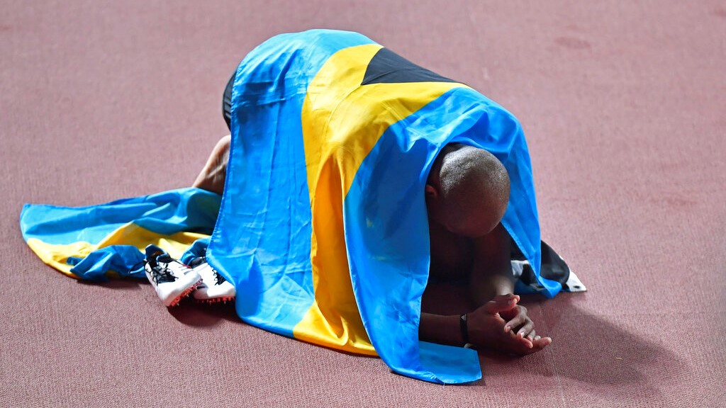 Gold medallist Steven Gardiner, of Bahamas, celebrates winning the men's 400 metre at the World Athletics Championships in Doha, Qatar, Friday, October 4, 2019. (AP Photo/Martin Meissner)