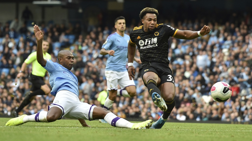 Wolverhampton Wanderers' Adama Traore, right, scores his second goal during the English Premier League football against Manchester City at Etihad stadium in Manchester, England, Sunday, Oct. 6, 2019. (AP Photo/Rui Vieira).