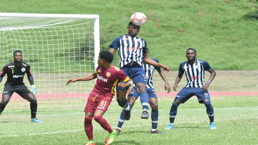Kristopher McDonald of Jamaica College heads a ball out during the remaining eight minutes of their urban area ISSA/Digicel Manning Cup game against Wolmer's Boys at the Stadium East field on Wednesday, October 16, 2019.  (PHOTO: Marlon Reid).