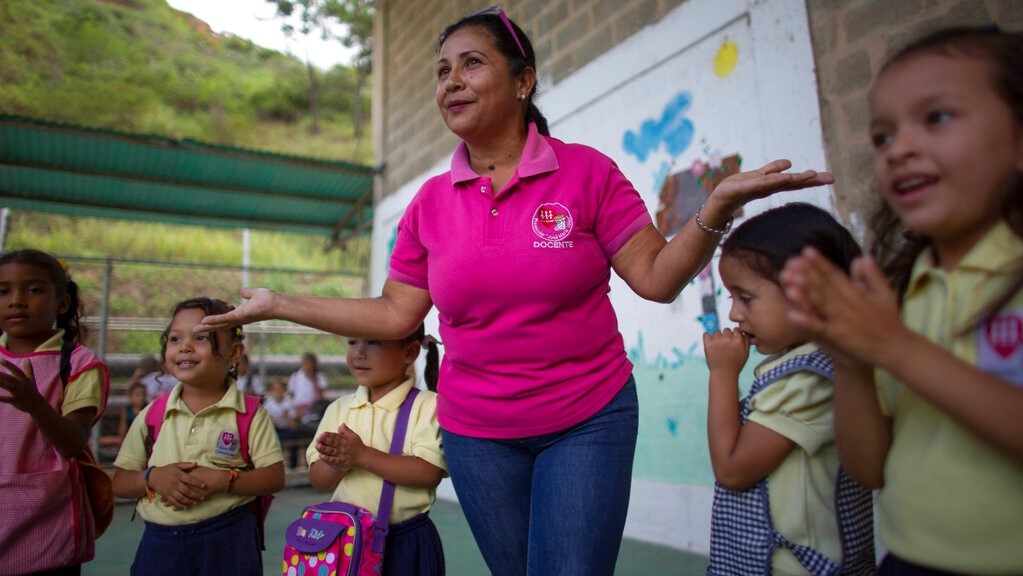 In this October 7, 2019 photo, teacher Daixy Aguero leads her students during an activity at a school in Caracas, Venezuela. (AP Photo/Ariana Cubillos)