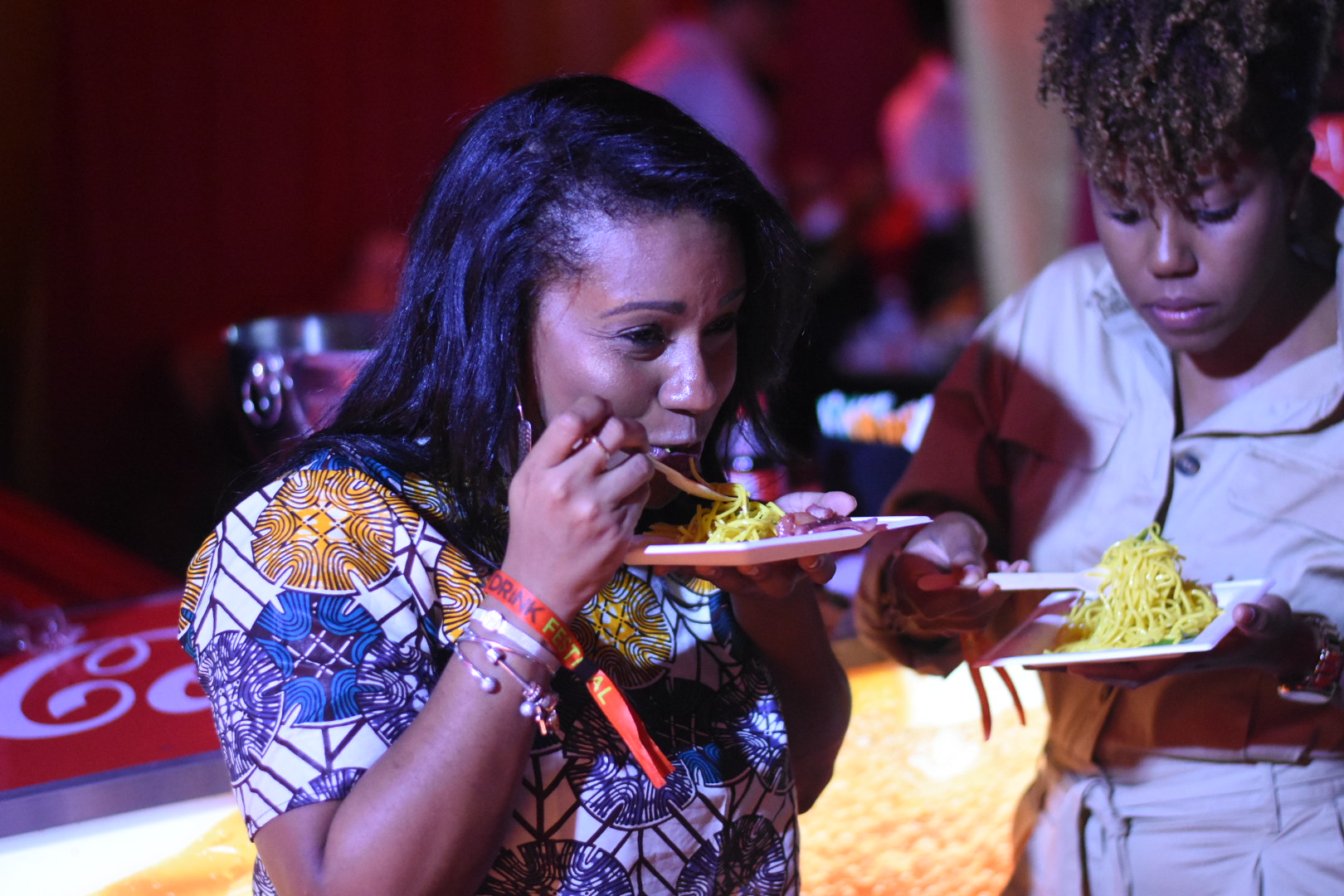 Attorney-at-law Stacy Earl (left) and architect Lorie McIntosh tuck into oriental fare at Chopstix. (Photos: Marlon Reid)