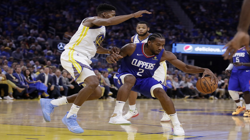 Los Angeles Clippers' Kawhi Leonard (2) drives the ball against Golden State Warriors' Glenn Robinson III, left, during the first half of an NBA basketball game Thursday, Oct. 24, 2019, in San Francisco. (AP Photo/Ben Margot).