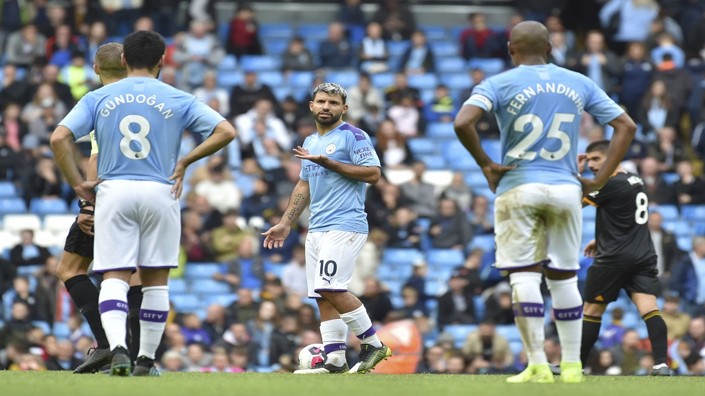 Manchester City's Sergio Aguero, centre, reacts towards team mates after Wolverhampton Wanderers' Adama Traore's scored his second goal during the English Premier League football match at the Etihad stadium in Manchester, England, Sunday, Oct. 6, 2019. (AP Photo/Rui Vieira).