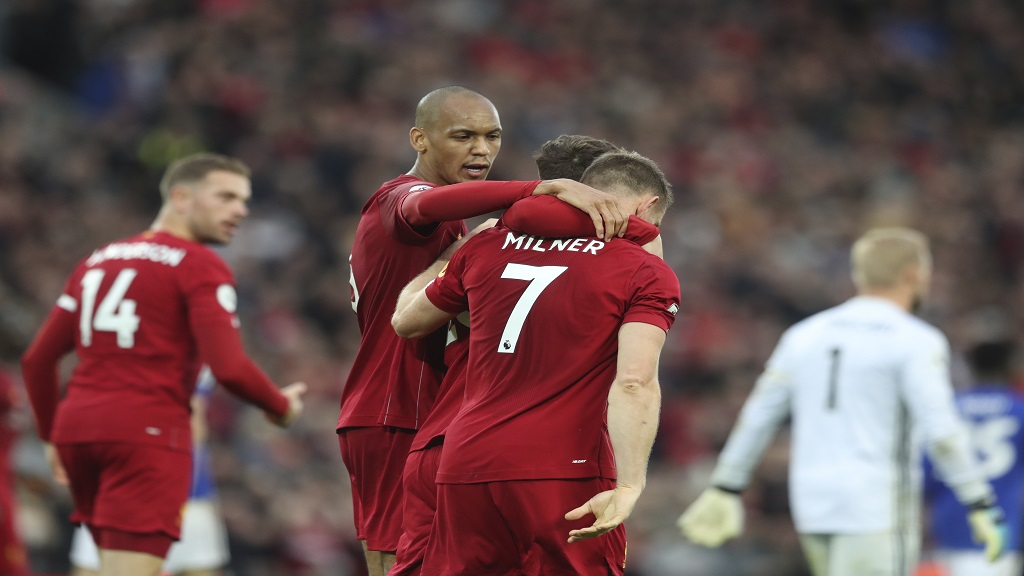 Liverpool's James Milner celebrates his wining goal during English Premier League football match against Leicester City in Anfield stadium in Liverpool, England, Saturday, Oct. 5, 2019. (AP Photo/Jon Super).