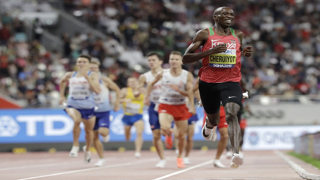 Timothy Cheruiyot of Kenya wins the gold medal in the men's 1500m at the World Athletics Championships in Doha, Qatar, Sunday, Oct. 6, 2019. (AP Photo/Petr David Josek).