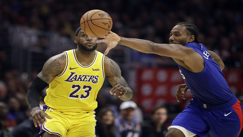 Los Angeles Clippers' Kawhi Leonard, right, steals the ball from Los Angeles Lakers' LeBron James (23) during the second half of their NBA basketball game Tuesday, Oct. 22, 2019, in Los Angeles. (AP Photo/Marcio Jose Sanchez).