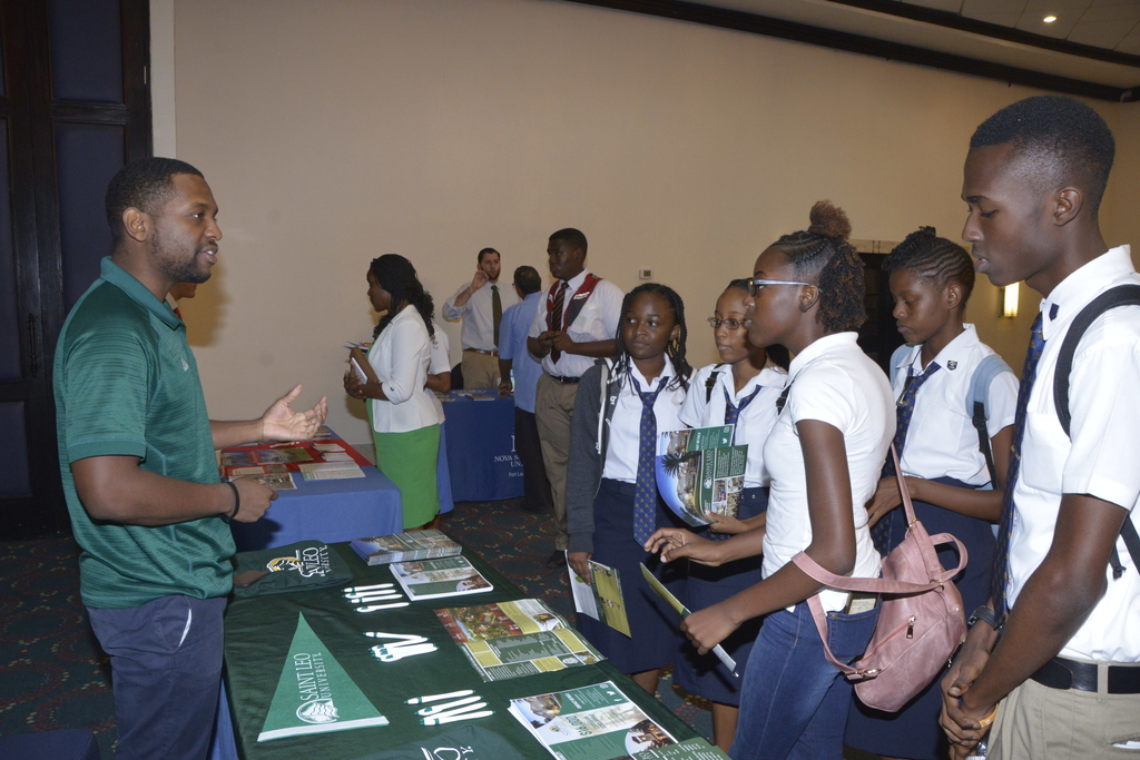St. Leo University representative shares information with high school students at the 2018 staging of the US Embassy's College Fair.