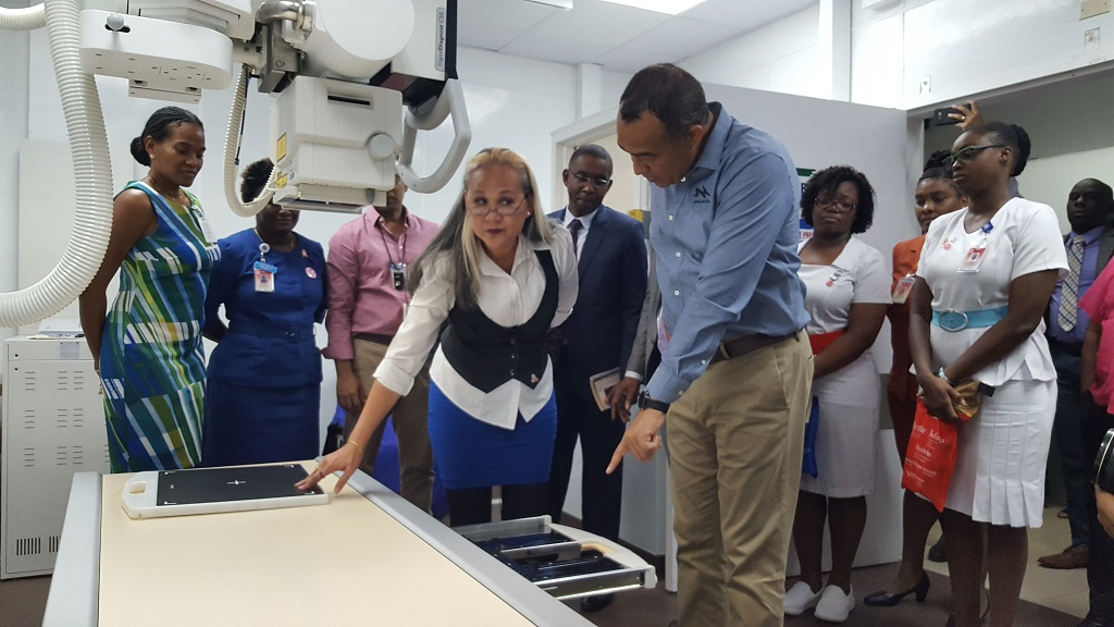 Health Minister Dr Christopher Tufton points to a feature of the new Phillips X-Ray machine at the University Hospital of the West Indies on Wednesday. (Photos: Marlon Reid)