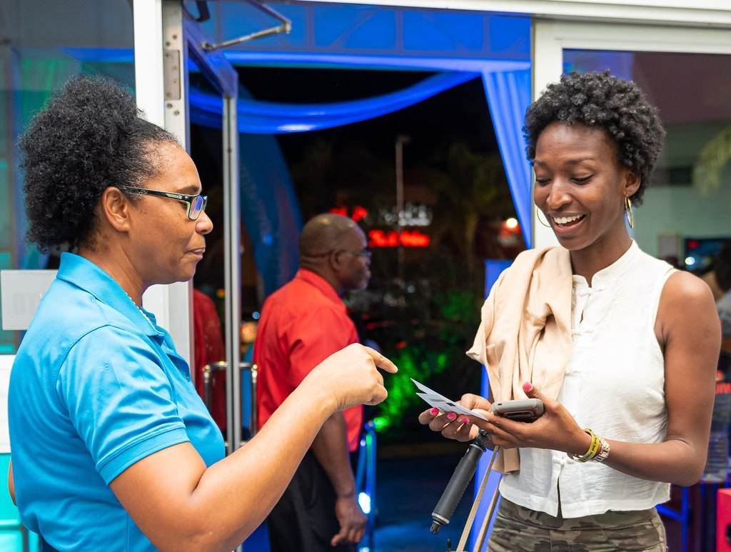 This movie goer was pleasantly surprised at the Palace Multiplex cinema in Montego Bay, St. James, when she learnt that her ticket and refreshment costs were covered by Sagicor Investments. Dawn Cooke (left), Sagicor Investments Wealth Advisor shares the good news.