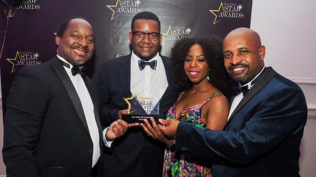 Barbados' Tourism team in the UK accept the 2019 Star award.