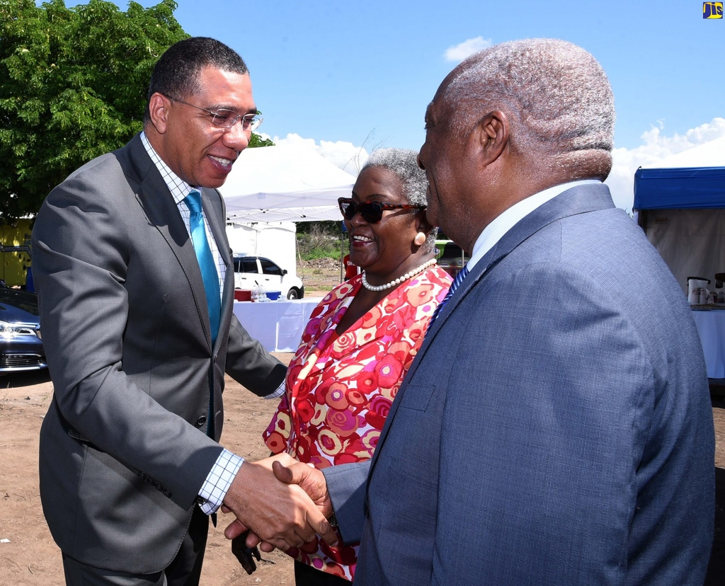 Prime Minister Andrew Holness (left), greets CEO and Chairman of Cari-Med Group Limited, Dr. Glen Christian (right), and wife, Marva Christian, shortly before the breaking of ground for the Group's new multibillion-dollar distribution centre in Bernard Lodge, St Catherine, on Wednesday. (Photo: JIS)