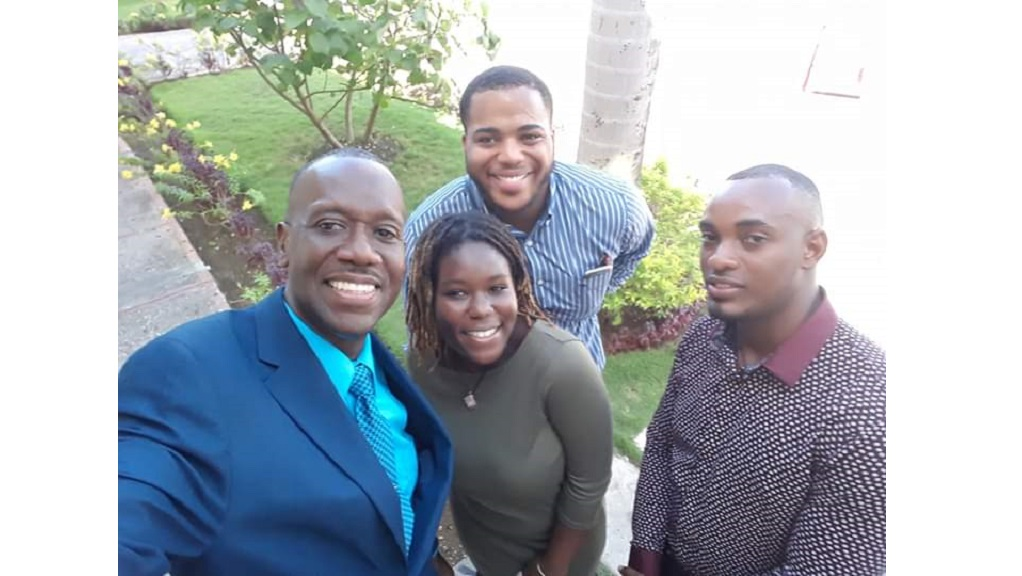 Paul Norman (left) takes a selfie moment with several of his mentees, including Laquaine Piper (second right).