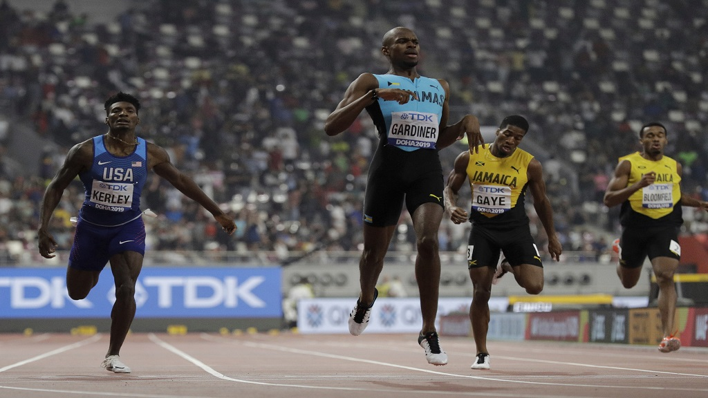 Steven Gardiner of Bahamas, centre, wins the gold medal in the men's 400m final at the World Athletics Championships in Doha, Qatar, Friday, Oct. 4, 2019. The Jamaican pair Demish Gaye (third from left) and Akeem Bloomfield  (fourth from left) came home fourth and eighth. (AP Photo/Petr David Josek).