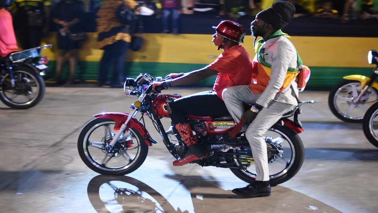 File photo of Sizzla  riding pillion on a motorcycle before receiving a Reggae Icon Award during the Jamaica 57 Independence Grand Gala at the National Stadium.