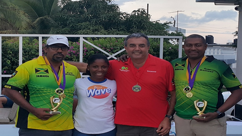 Ryan Bramwell, (far right) and Darrin Richards (far left) show off their trophies after winning their respective divisions at the Liguanea Cup Pistol Shooting Competition, which was held at the Jamaica Rifle Association's (JRA) headquarters in Kingston over the weekend.