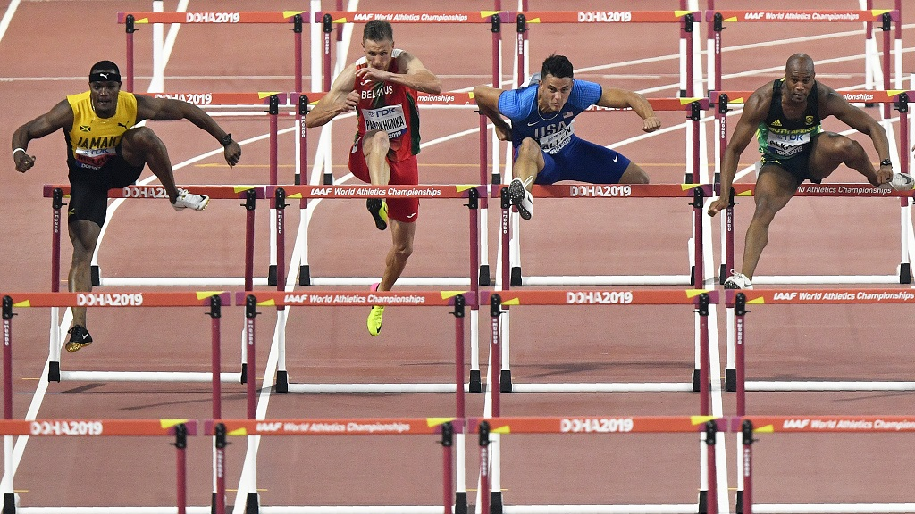 Omar Mcleod, of Jamaica, Vitali Parokhonka, of Belarus, Devon Allen, of the United States, and Antonio Alkana, of South Africa, from left to right, compete in the men's 110m hurdles heats during the World Athletics Championships in Doha, Qatar, Monday, Sept. 30, 2019. (AP Photo/Martin Meissner). McLeod returns to action on Wednesday in the semifinals along with three other Jamaicans.