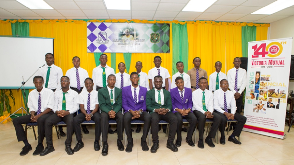 The 19 recipients of the  David 'Wagga' Hunt Scholarship Foundation, from Kingston College (KC) and Calabar High, at the 11th annual awards ceremony at the Institute of Chartered Accountants of Jamaica auditorium in Kingston.