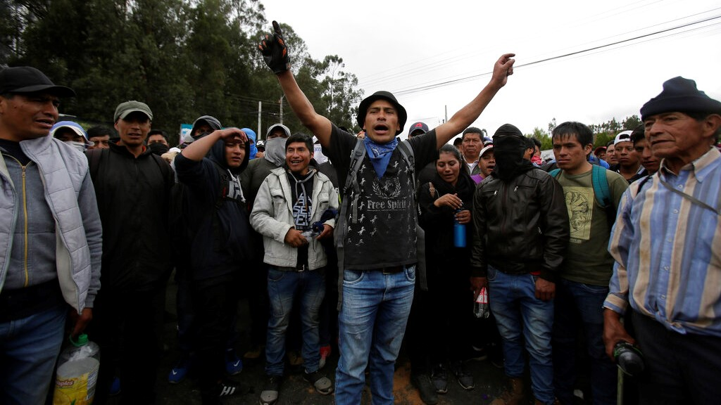 Residents block a main road during a transport strike that shut down taxi, bus and other services in response to a sudden rise in fuel prices, in Cangahua, Ecuador Friday, Oct. 4, 2019. (AP Photo/Dolores Ochoa)