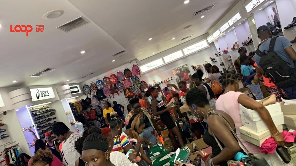 Customers in Sole Addiction Barbados store for the sale on Monday, October 7, 2019.