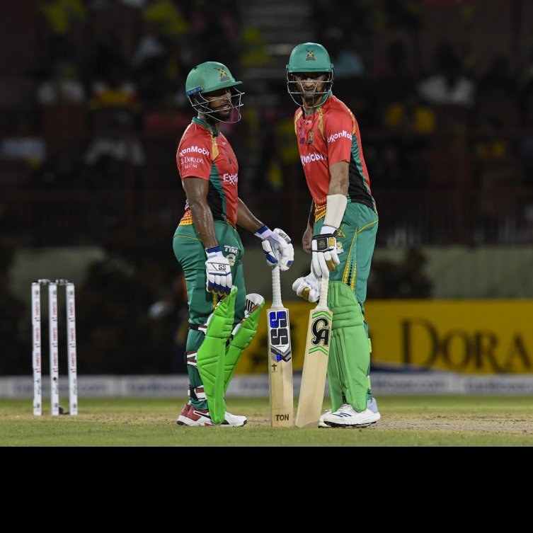 Nicholas Pooran (left) and Shoaib Malik put on an unbroken 4th wicket partnership of 85 runs to win the match for Guyana Amazon Warriors