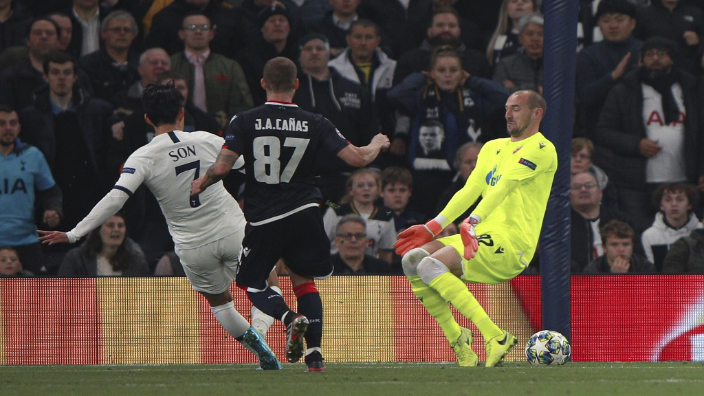 Tottenham's Son Heung-min, left, scores his side's third goal during the Champions League, Group B,  match against Red Star Belgrade, at the Tottenham Hotspur stadium in London, Tuesday, Oct. 22, 2019. (AP Photo/Ian Walton).