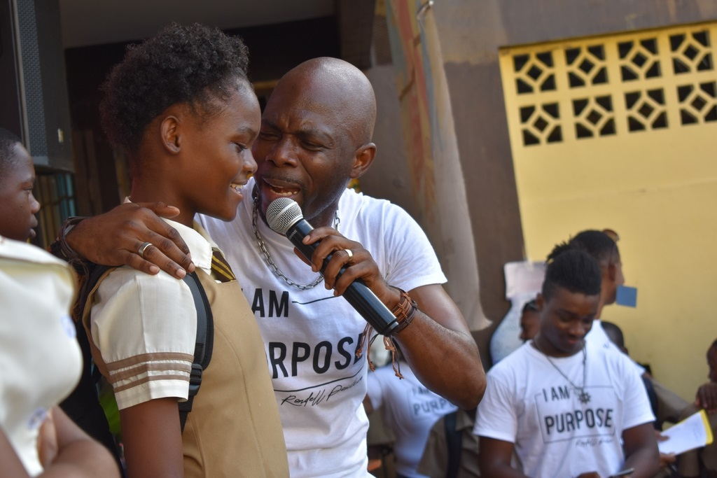 A student of the Charlie Smith High School joins Rondell Positive on stage to share in the fun and adding her flavor to the mix at recent Open to Purpose devotional session at the school.