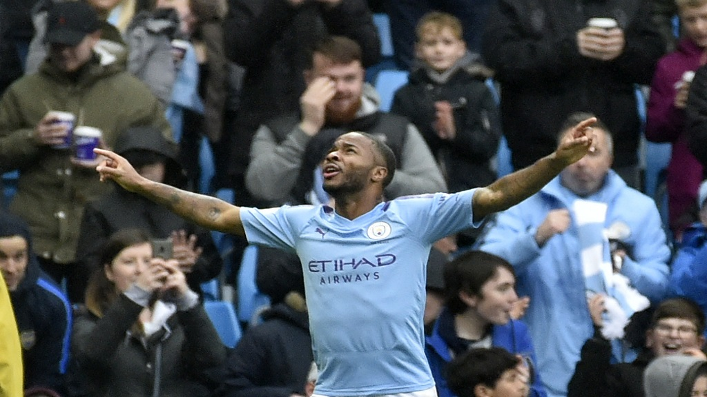 Manchester City's Raheem Sterling celebrates after scoring his side's first goal during the English Premier League football match against Aston Villa at Etihad stadium in Manchester, England, Saturday, Oct. 26, 2019. (AP Photo/Rui Vieira).