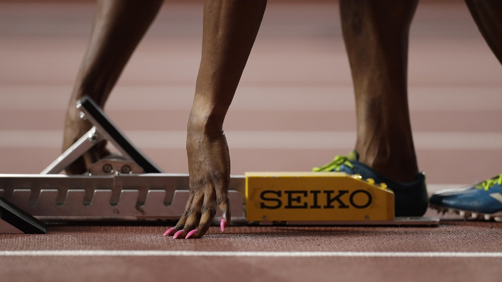 Patience Okon George, of Nigeria adjusts her starting blocks before a women's 400M heat at the World Athletics Championships in Doha, Qatar, Monday, Sept. 30, 2019. (AP Photo/Petr David Josek).
