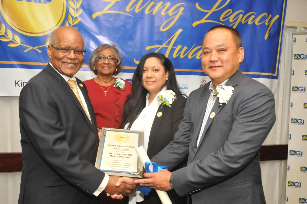 Former Governor General Sir Kenneth Hall (from left) and Lady Hall, present Edith and Jukie Chin with the J. Lester Spaulding Award for Business, at the Caribbean Community of Retired Persons (CCRP) 2019 Living Legacy Awards recently.