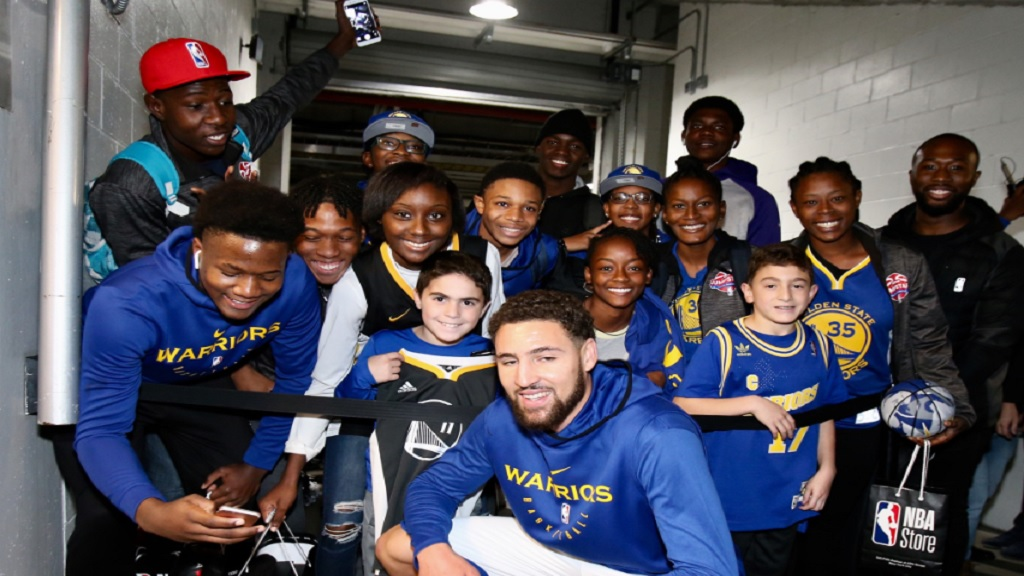 2018 Digicel NBA Jumpstart's young basketballers with Golden State Warriors' Klay Thompson during their NBA Experience.