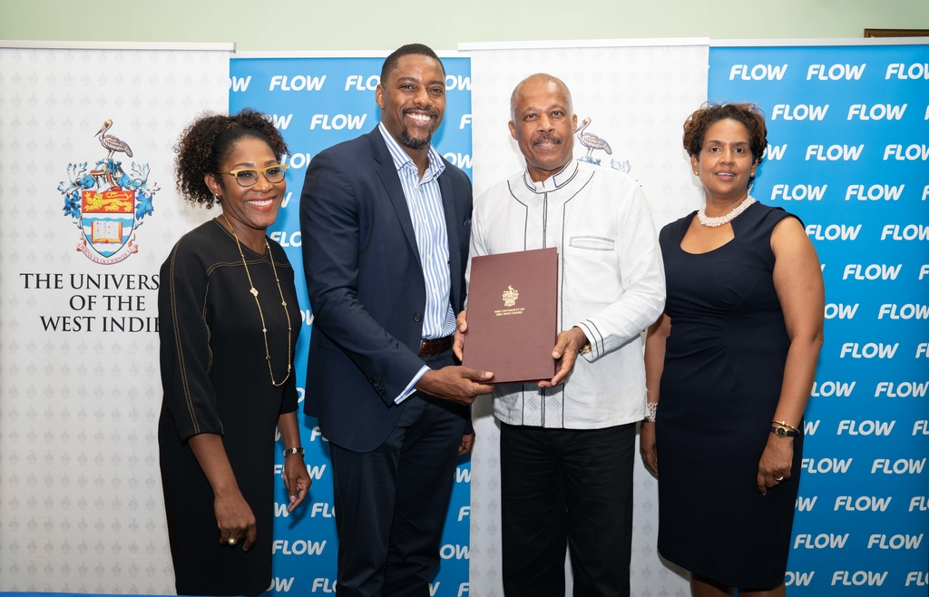 L-R: Marilyn Sealy, Senior Manager, Communications, Southern Caribbean, Flow, Jenson Sylvester, Country Manager, Flow Barbados, Professor Sir Hilary Beckles, Vice-Chancellor of The University of the West Indies and Janet Caroo, Managing Director, UWItv posing for a photo following a signing ceremony to launch a partnership between UWI and Flow.