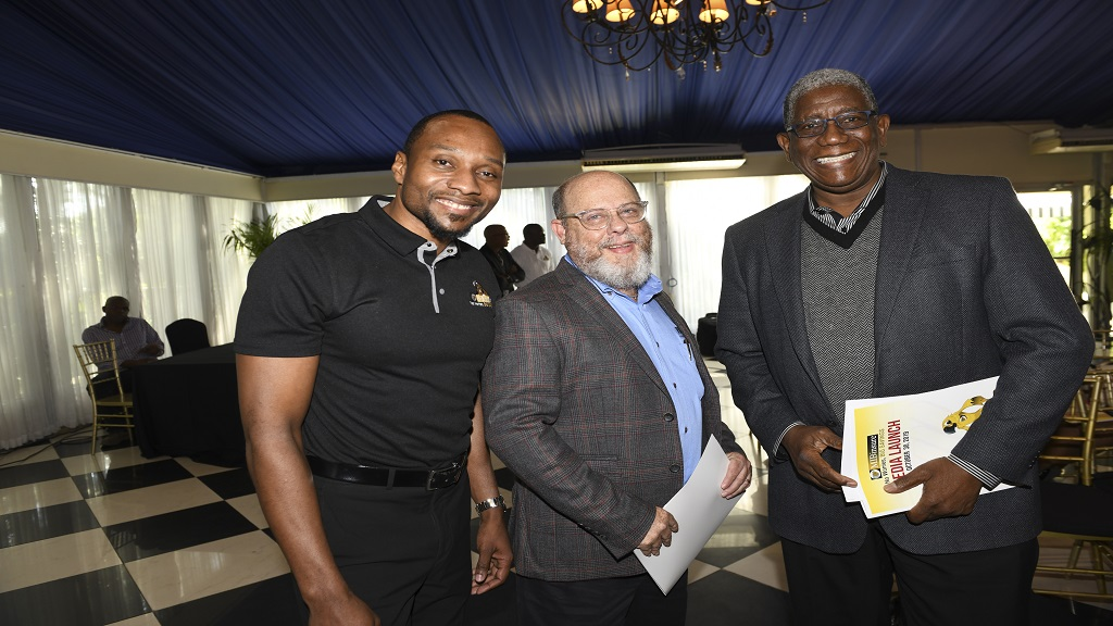 From left: Levar Smith,  CEO of Marathon Insurance Brokers Limited, Peter Levy,  President of the Insurance Association and Richard Burgher, Commerce and Chairman of Marathon Insurance.